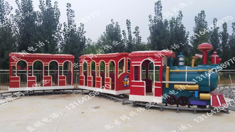 厂家热销现货雪地坦克车 旋转飞碟 儿童火车 小蹦极 太空环