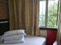 天天红宾馆~月租房~超低价~免费停车