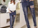 欧洲站新款哈伦牛仔裤 刺绣铅笔小脚裤 磨破 贴布长裤
