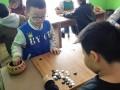洛阳弈学堂少儿围棋火热招生中 报名一年送棋具