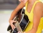 郑州哪里买民谣吉他价格便宜性价比高有民谣吉他培训?