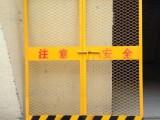 遵义金科实地蔷薇美的城工地专用施工电梯门黄色对开两扇价格