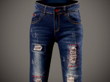 实拍时尚膝盖破洞牛仔裤女 个性徽章哈伦裤