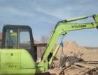 现代605挖掘机带背车