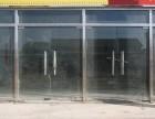 阜成门安装地弹簧玻璃门安装合页门