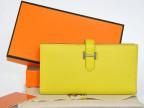 爱马氏 二折长款钱包柠檬黄色手掌纹togo原版皮H字扣女钱包男钱包