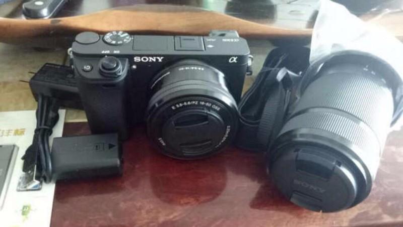 惠州个人出闲置索尼微单送双镜头