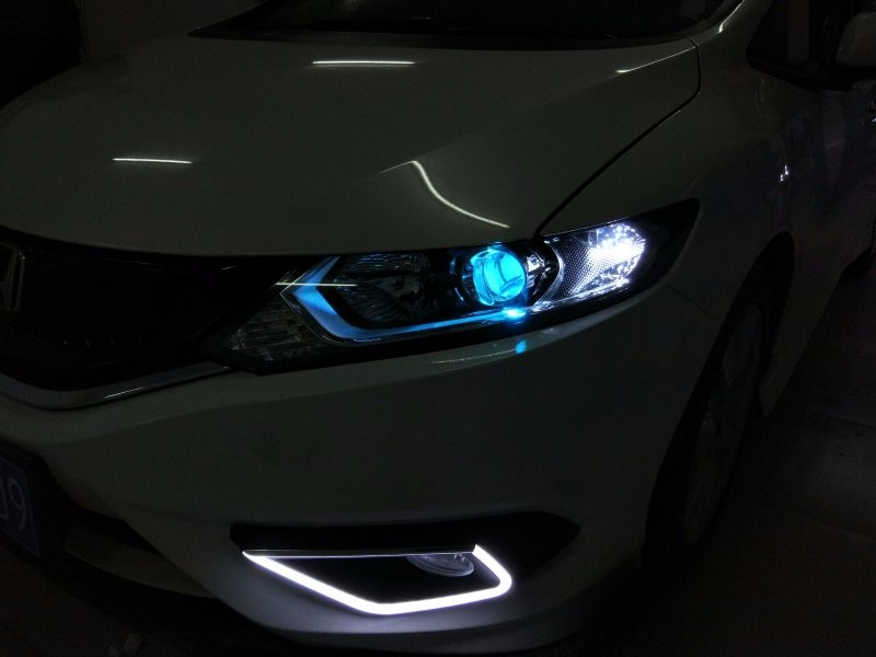 汽车大灯改装 汽车灯光改装升级 沧州夜行者汽车大灯改装高清图片