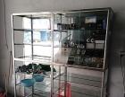 新到一批不锈钢玻璃货架、彩电、沙发出售