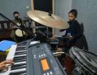 九龙坡盘龙小学学钢琴吉他架子鼓绘画素描去向日葵艺术培训