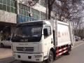 国四东风锐铃6吨压缩式垃圾车