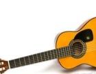 闲置的吉他2把其中一把是老款红棉的经典绝版款