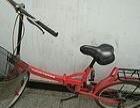 2台红色的20折叠自行车出售价格每个260.
