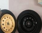 新车拆下来的14寸轮毂和三角牌轮胎