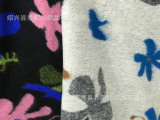 乔阳纺织 粗纺毛呢面料 针织提花 不规则水草花花型 女装大衣面料