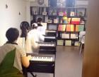 暑假想学钢琴 学吉他 来番禺市桥雅乐琴行