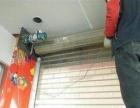兴达卷帘门车库门,玻璃门安装维修防盗门,换锁配遥控