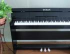 福建泉州德曼电钢琴厂家批发红色烤漆上线批发的价格低至几百元